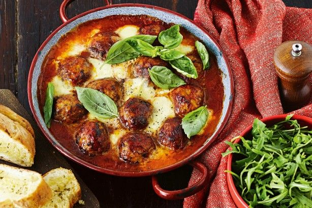 Oven baked meatballs in cheesy tomato sauce