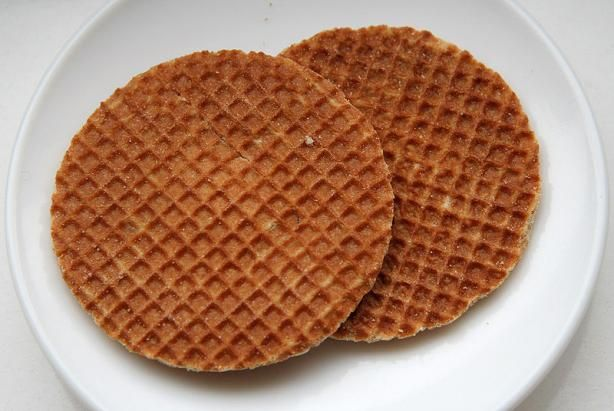 Stroopwafels, the favorite cookie of the Dutch, is a waffle made from two thin layers of baked batter with a caramel-like syrup filling in the middle. (English translation: syrup waffle!)