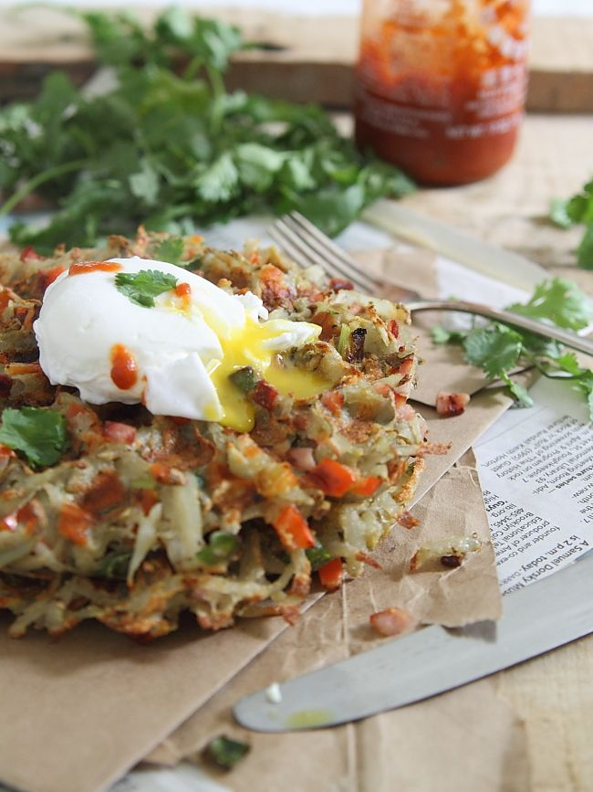 Southwestern hash brown waffles with poached eggs. Ingredients: green onions, ham, red pepper and topped with a spicy poached egg for a crispy