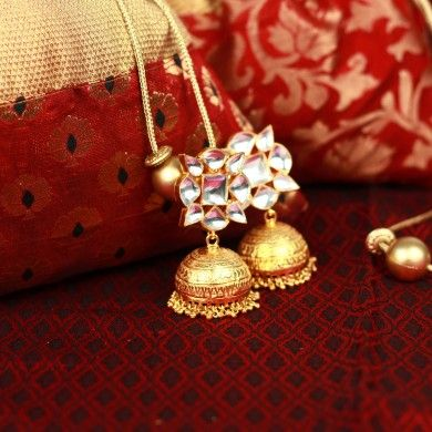 Traditional Indian kundan settings meet the classic gold plated jhumki in this creation, featuring textured work. These earrings can also be crafted in gold and diamonds upon request. Email us at info@cherrytin.com for details.
