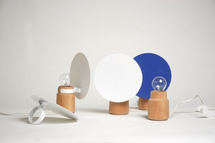 Shelf Lamp --made of pine and laquered metal, gives light to the surrounding planes and defines the volume/space in the shelf itself; launched by David Design in Stockholm, 2012.