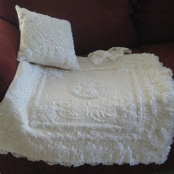 Show off your wedding gown every day with a quilt from Mary Manson Quilts, made entirely out of your gown. You can also have a matching pillow made if there's enough fabric!