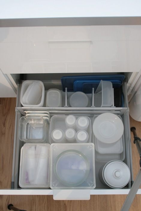 Organize small Tupperware using dividers in a deep drawer (+ other organization tips on this site)