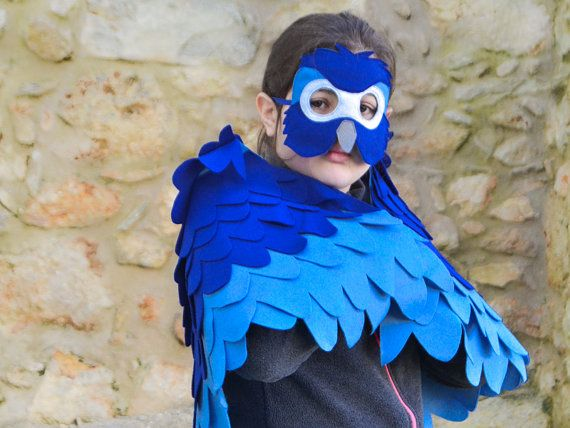 Blue arara parrot costume for children.  This blue bird wing and mask set was inspired by the animation film Rio that is an ever fovourite among kids. However, I used to shades of blue for the parrot costume instead of one, to make it even more fun and colorful.  I used wool blend felt that I hand cut and machine stitched. The mask as well as the wings have an extra felt backing for more durability. The wings can be secured comfortably and easily onto the lower and upper arms with elastic…