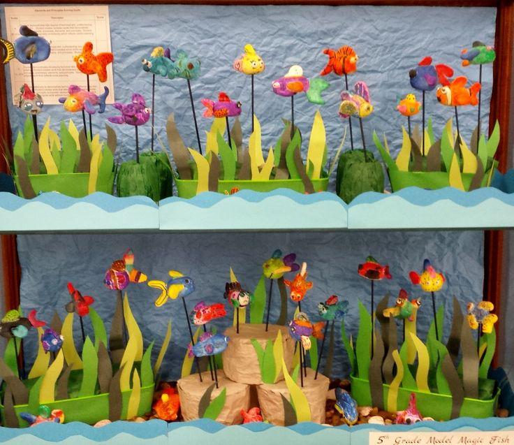 An aquarium display of my 5th grade 3D Fish made using white crayola model magic