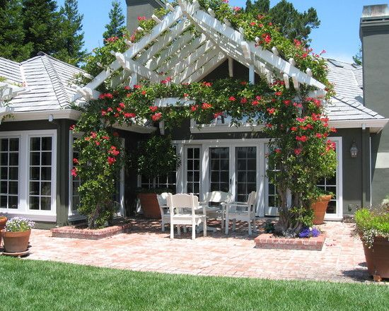 Excellent Pitched Roof Pergola To Complete Your Patio : Cute Pitched Roof Pergola Combined With White Armchairs And Red Flowers