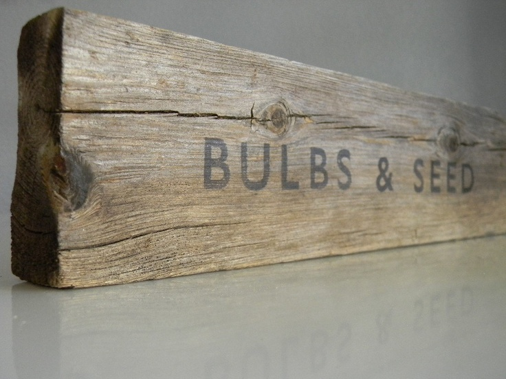 Rustic garden sign, the font, and black on old wood.