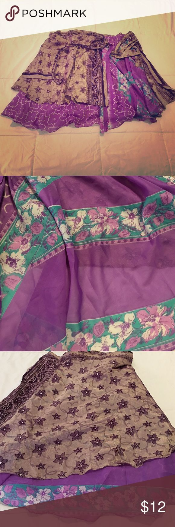 Kariza Skirt/Wrap Beautiful purple floral and geometric print Kariza wrap. Add this multifunctional concept piece to your wardrobe-you won't be disappointed! ❤️perfect condition. Will fit most sizes. Kariza Dresses