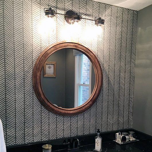 A DIY stenciled bathroom accent wall achieves a wallpaper look using the Herringbone Stitch Allover Stencil from Cutting Edge Stencils. http://www.cuttingedgestencils.com/herringbone-stitch-allover-pattern-wall-stencil.html