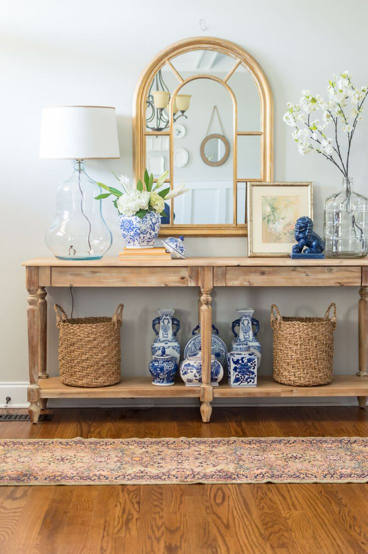 Spring entryway refreshed with World Market Everett table, blue and white pieces and fresh spring flowers. via @homeicreate