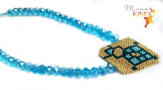 african beaded necklace, turquoise and gold, handmade, Collier de perles africain: Croix d'Agadez par MinaKindo sur Etsy