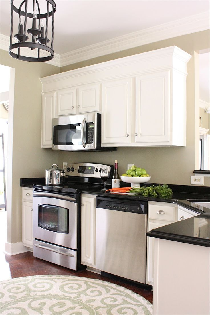 The Yellow Cape Cod: Making Cabinets Taller {Builder Cabinets Go Custom With Molding}