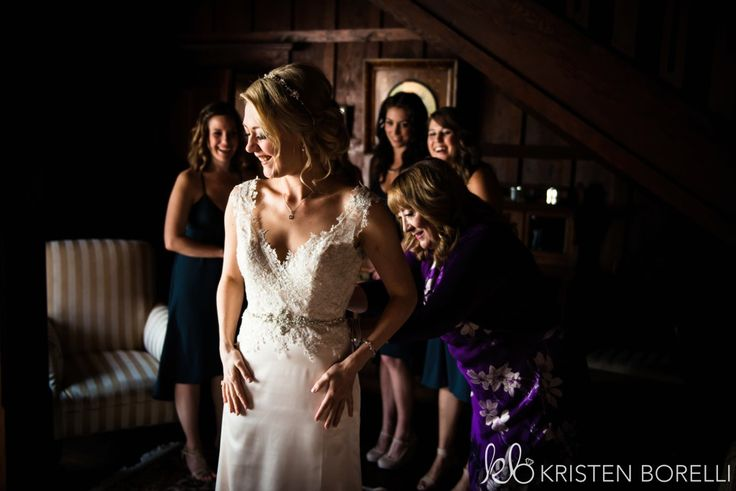 Thetis Island Overbury Resort Wedding. Bride getting into her lace and silk gown.
