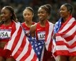 Bianca Knight, Allyson Felix, Tianna Madison and Carmelita Jeter of the U.S. celebrate after they gold in the women's 4x100m relay final during the London 2012 Olympic Games