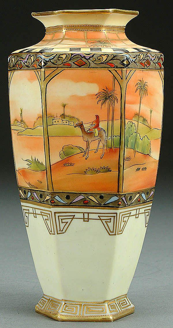 A NIPPON MAN ON CAMEL DECORATED PORCELAIN VASE CIRCA 1910 WITH HAND PAINTED SCENE ON 6-PANEL FORM