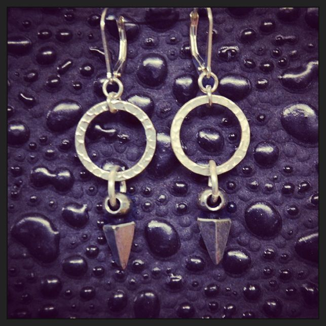 Smitten Designs spike earrings with sterling silver hammered hoops, sterling hooks & base metal spikes. Available at Fine Finds Boutique in Vancouver & So Blu Clothing in West Vancouver.