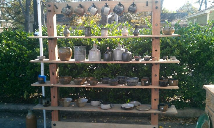 Homemade display shelves for pottery. Comes apart for easy transportation.Delafield Pottery