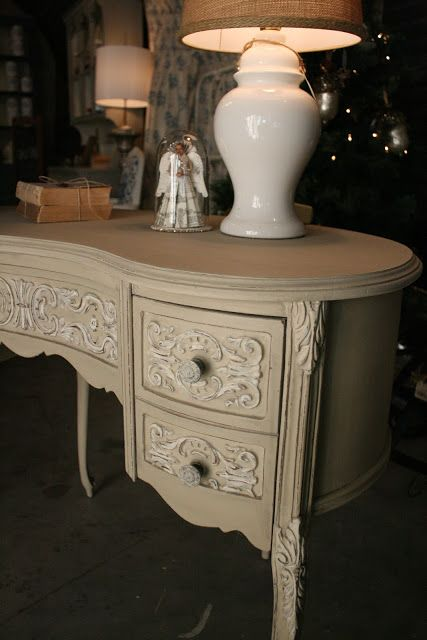 KIDNEY VANITY after ~ for this special piece of furniture, I chose one of my favorite colors of Chalk Paint: Country Grey. I wanted the carved, scrolling details to stand out, so I dry brushed Old White over them and then distressed, allowing the wood underneath to show through. To soften the contrast between the Country Grey and Old White, I went over them with a wash made by mixing half French Linen and half water.