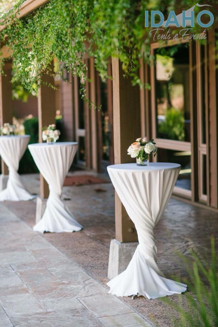 Using A 132 Linen On A Cocktail Table Allows Extra Length To Create A Unique Design For Your Cocktail Hour Decor Wedding Cocktail Tables Cocktail Table Decor