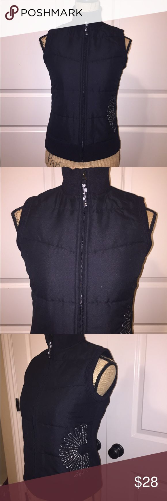 "Lole Vest Lole vest. Black vest with fleece lining in back. Puffer look on front with white floral stitching on left side. Small zippered pocket on bottom front. Quick dry, breathable vest. 23"" length.100% polyester. Size S. Lole Jackets & Coats Vests"