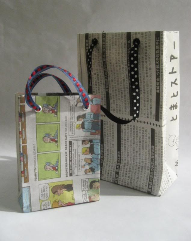 Gift bags made from recycled newspapers!  How cleverly cute!    www.craftster.org