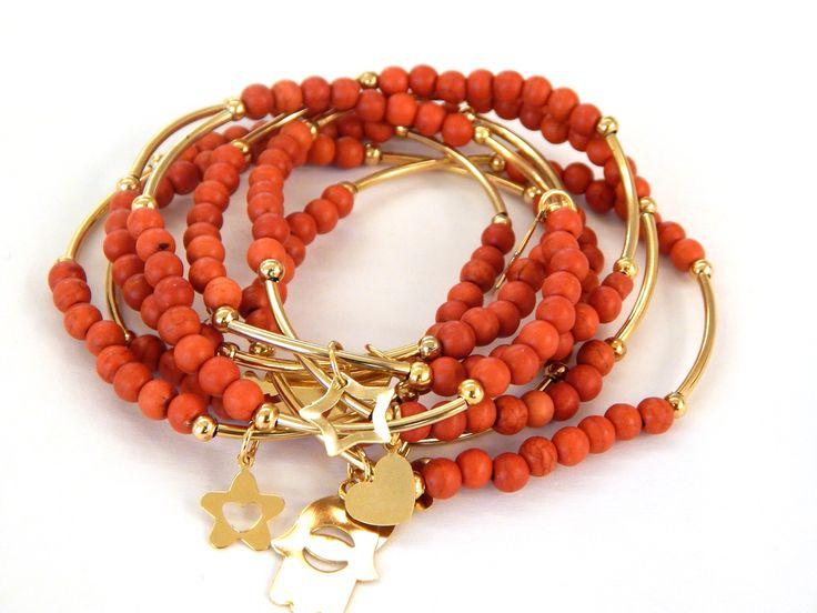 Modelo: SBP4012. Semanarios de chapa 14k con bola de pasta color naranja, precio por juego de 7 pulseras $120.00 pesos,precio especial a mayoristas.