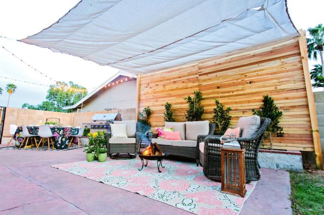 This cement patio became a covered lounge and dining spot with a few updates.