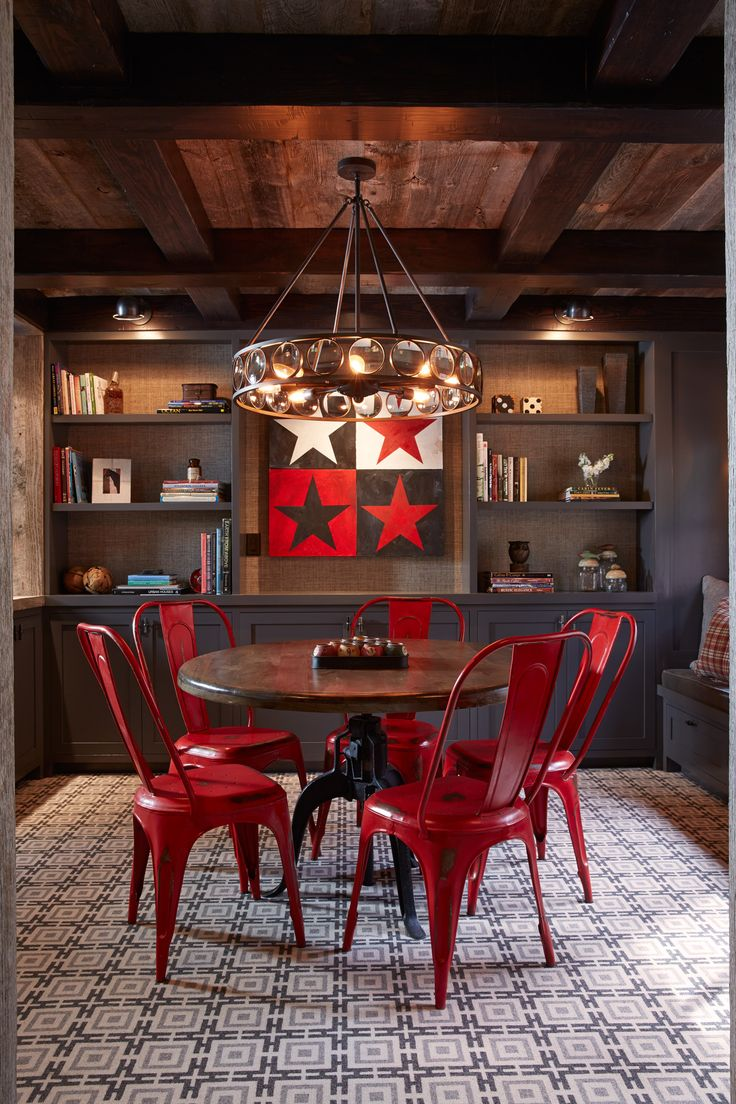 Dream house game room - Spectacular Game Room With Red Retro Chairs Deep Gray Bookshelves Chandelier And Patterned Rug