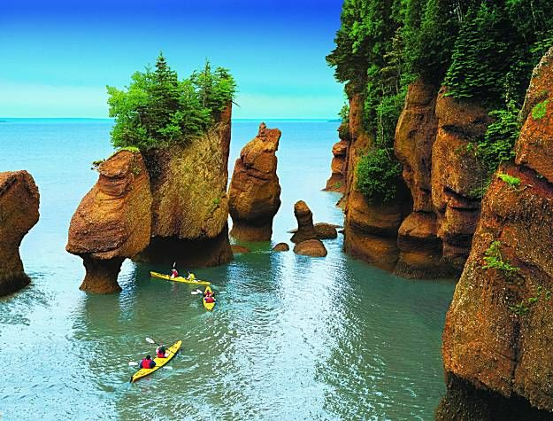 Bay of Fundy, Nova Scotia, Canada.    Tide changes every 6 hours.  High and low tide vary by 50 feet, the greatest height in the world.