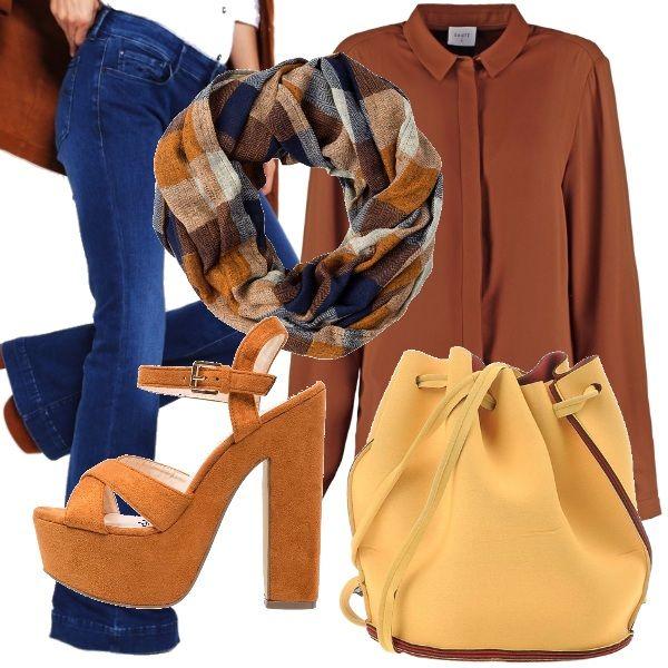 I jeans a zampa non passano mai di moda...ecco il mio abbinamento: camicia in seta color terra di Siena, sandali ocra con tacco largo e plateau, scaldacollo con fantasia scozzese nei toni del blu e del marrone e borsa a secchiello gialla con profili marroni.