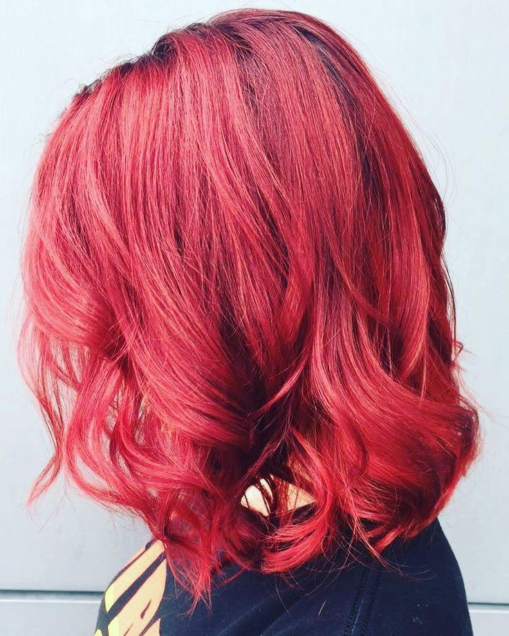 Trends 2018 - Red Hair Color : Red hot true red Aveda hair color on a wavy lob by Aveda Artist Marisa Cushman. #Red https://inwomens.com/2018/02/04/trends-2018-red-hair-color-red-hot-true-red-aveda-hair-color-on-a-wavy-lob-by-aveda-artist-marisa-cushman/