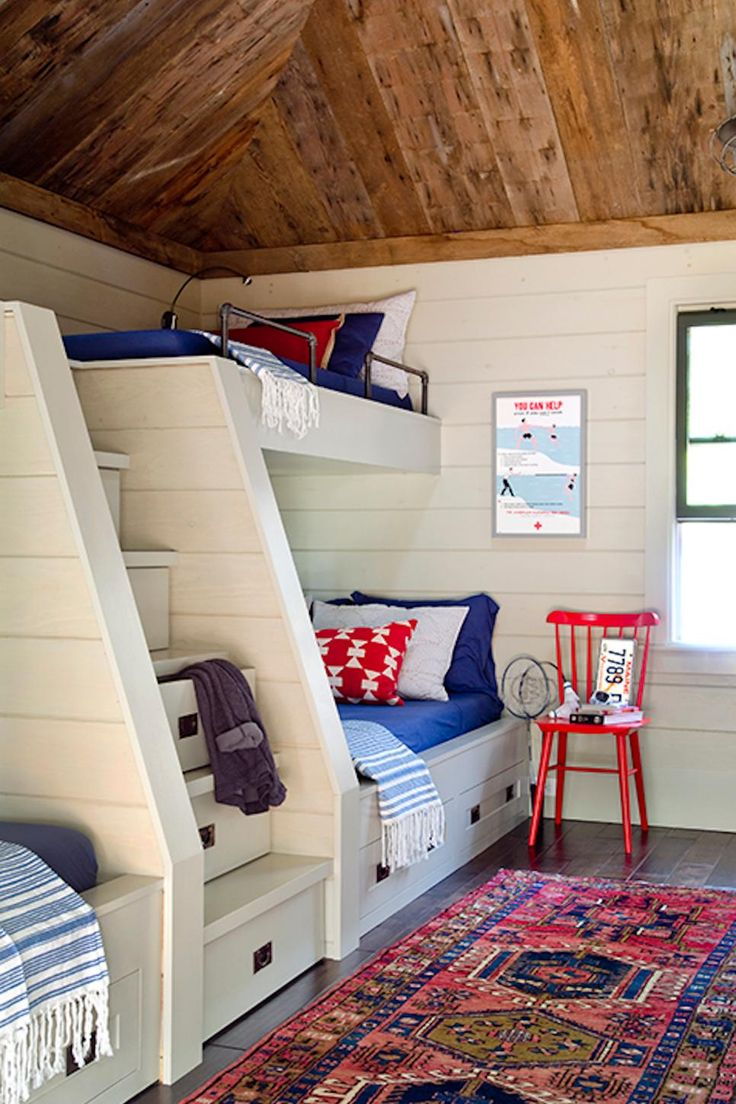 This cozy cabin-style home from Kristina Crestin features reclaimed wood beams and floors, vaulted ceilings and plush furniture to create a sweet lakeside retreat where the whole family can gather.