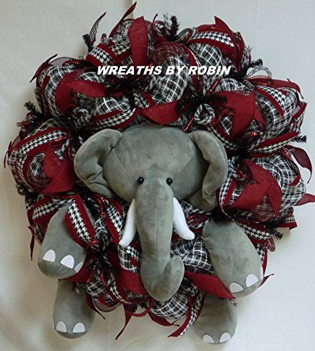 Alabama Sports Wreath, Alabama Elephant Wreath, College Wreaths. BOXED AND READY FOR SHIPPING! This super cute Alabama Elephant wreath will look awesome on your front door this year for football season! This wreath is a brand new design for 2016! This wreath was made on a deco mesh work form with lots of basket weave deco mesh, deco mesh ribbon, hounds tooth ribbon and a large elephant in the center of the wreath. Big, bold and Beautiful! Thank you for shopping with Wreaths by Robin!.