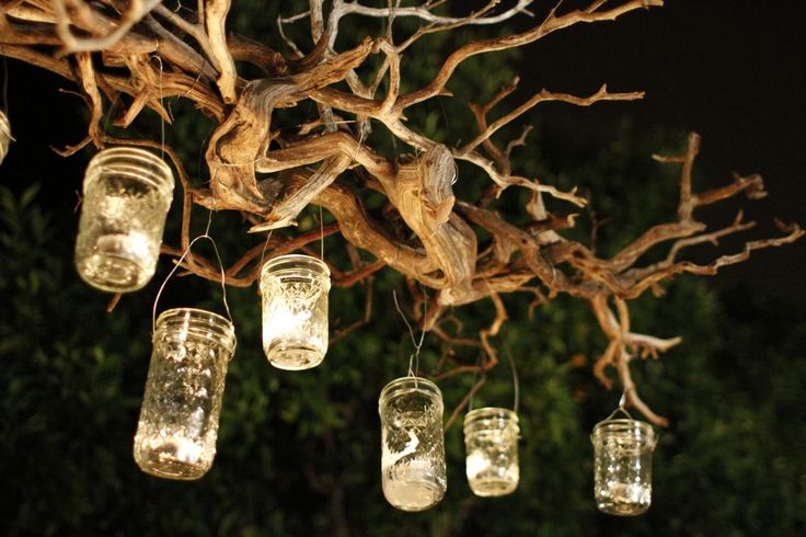 My friend Ellen bought an old chandelier and hung it from a shepherd's hook in her back yard, which happened to border a swamp! It was so Southern Gothic and shabby chic. This sort of works in the same way.