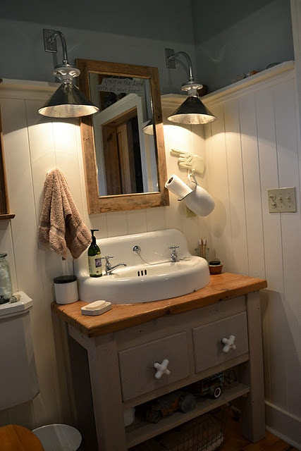 I love this farmhouse bathroom. The pitcher paper towel holder is a great idea, may go near the sink on our porch