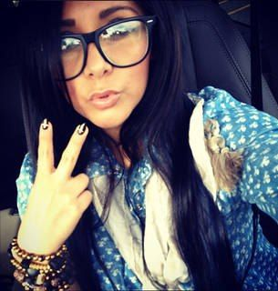 Snooki with her glasses !