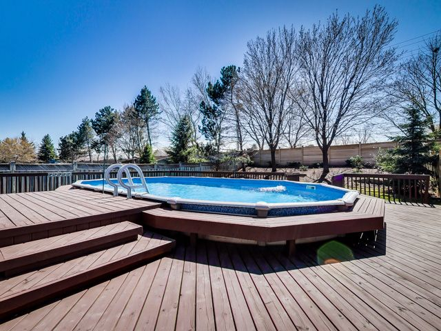 and a backyard tiered deck seamlessly integrated into an above ground pool. Let the entertaining begin.