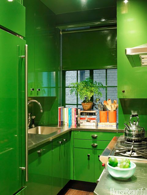 "The cabinets in the kitchen of this New York apartment by designer Miles Redd are lacquered in Bamboo Leaf by Fine Paints of Europe, as was the roller shade by Manhattan Shade & Glass. Redd says, ""We pumped up the color just a scootch and lacquered it to give it life."" Even the Sub-Zero refrigerator is painted green."