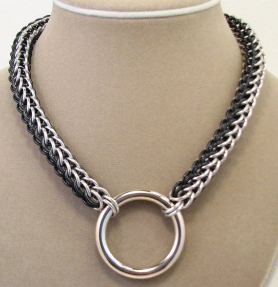 Black & silver necklace...lol.  i love it when people pin bdsm collars and call them necklaces.  this one, especially, looks exactly like what it is...a collar to chain someone to something naughty with!