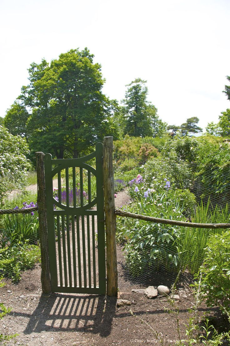 I love the idea of a rustic gate and fence surrounding a perennial garden!