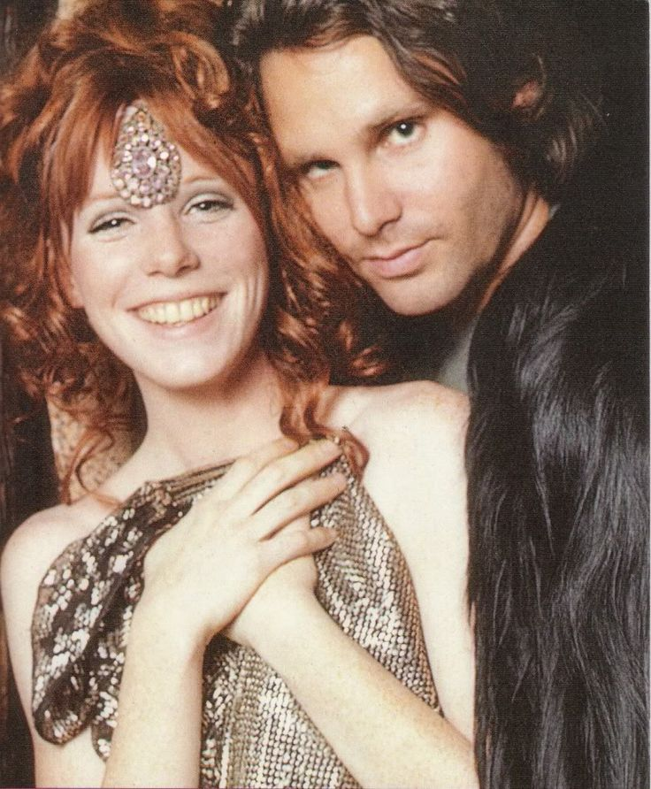 Jim Morrison + Pam = Love. This looks like us photgraphed at Jim's old house in Venice (without the hats). ~ETS