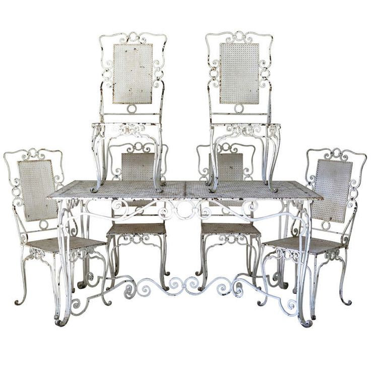 Baroque wrought iron table and six chairs france 1940s