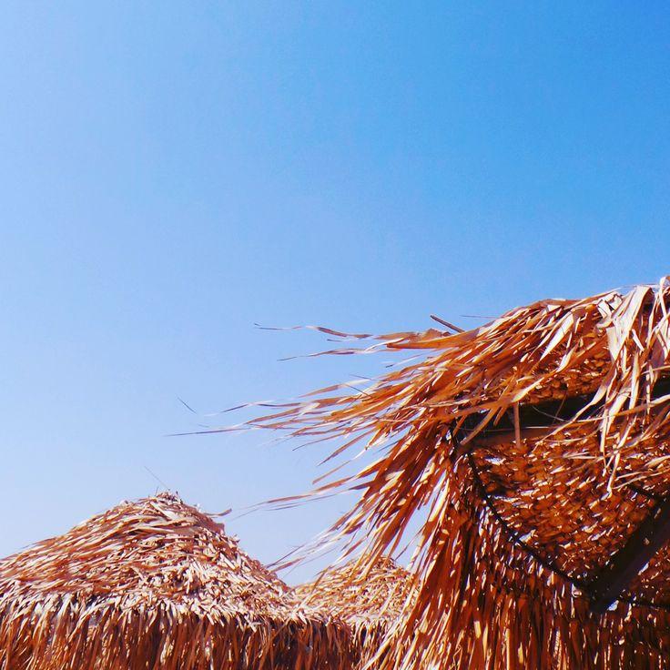 Sun unbrellas against a brilliant blue sky in Mykonos.. #mykonos #holiday #umbrella #bluesky #sun #mykonoslife #visitgreecegr #contrast #travel #mediterranean #colour #beach