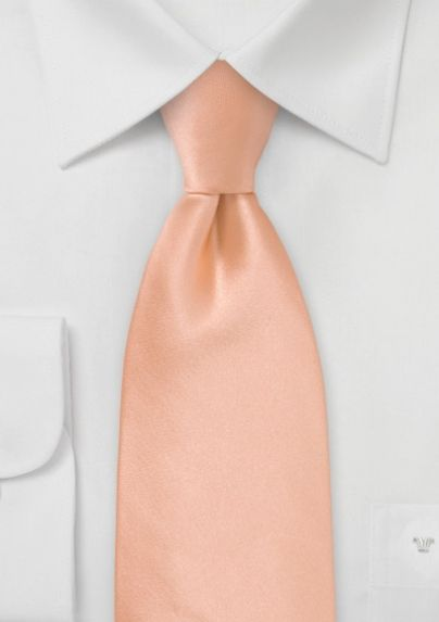 A tan suite with peach tie would be super pretty with girls in midghtnight blue dresses.