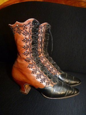 """Evening Lace-up Jet Beaded Boots from Vienna, circa 1895.  They are made of two colors of leather, with hand beaded steel and red glass beads done in a creative and beautiful design down the sides for closure. They are lined in violet silk with """"CAPEK. WIEN"""" signed inside. The boots have black shoe laces, pointed toes, and 2"""" Louis heels."""