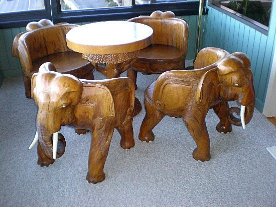 Hand Carved Teak Elephant Table & Four Chairs aren't these great? I love them. They are so....well let's use unique...