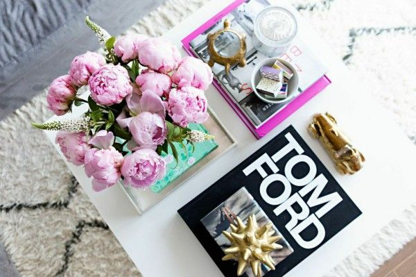 Coffee table perfection: flowers + fashion boots and touches of gold // via @glitterguide