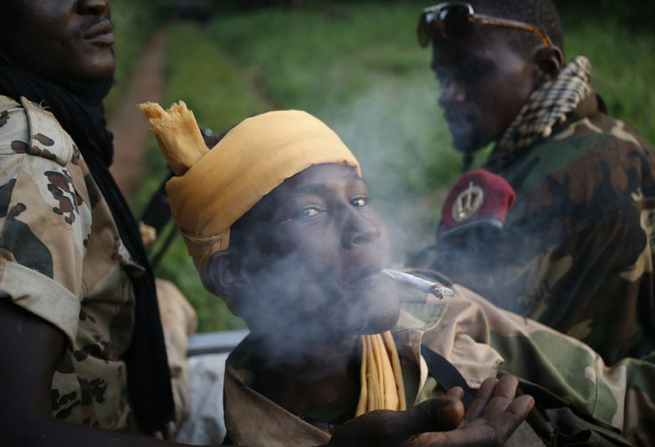 A Seleka fighter smokes during a patrol, close to the border of the Democratic Republic of Congo, in Central African Republic, June 10, 2014.REUTERS/Goran Tomasevic