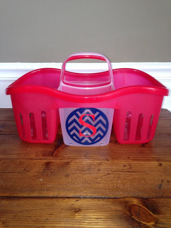 red plastic shower caddy with navy chevron monogram