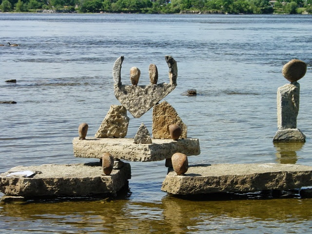 The JOY of being balanced.... rock sculpture by John-Félice Ceprano, a familiar figure during the summer, as he constructs these works of art at Remic Rapids, in the Ottawa River